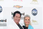 Entertainer Wayne Newton (L) and Kathleen McCrone arrive at the 2013 Billboard Music Awards at the MGM Grand Garden Arena on May 19, 2013 in Las Vegas, Nevada.