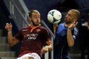 Fedreico Balzaretti #42 of AS Roma battles Marco DiVaio #9 of the MLS All-Stars for a loose ball during the 2013 Major League Soccer All Star Game at Sporting Park on July 31, 2013 in Kansas City, Kansas.