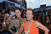 Katy Perry and Richard Simmons attend the 2013 MTV Video Music Awards at the Barclays Center on August 25, 2013 in the Brooklyn borough of New York City.
