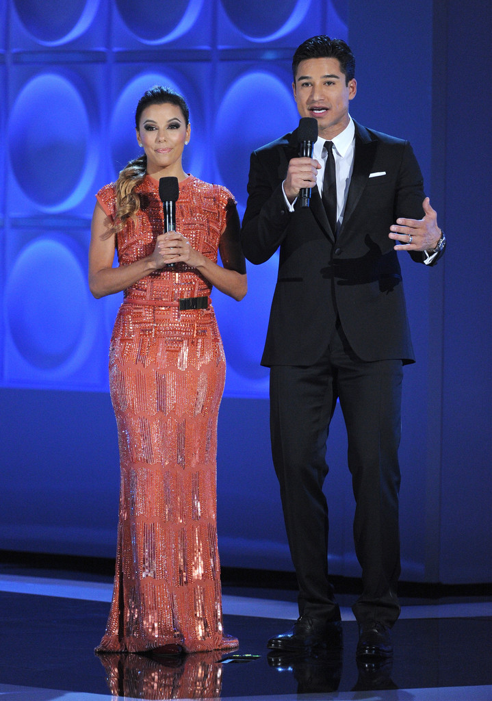 Actress Eva Longoria (L) and host Mario Lopez speak onstage during the 2013 NCLR ALMA Awards at Pasadena Civic Auditorium on September 27, 2013 in Pasadena, California.