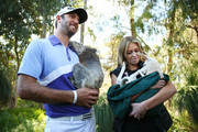 Dustin Johnson of the USA nurses a Koala with his partner Paulina Gretzky as she nurses a Joey during day two of the Perth International at Lake Karrinyup Country Club on October 18, 2013 in Perth, Australia.