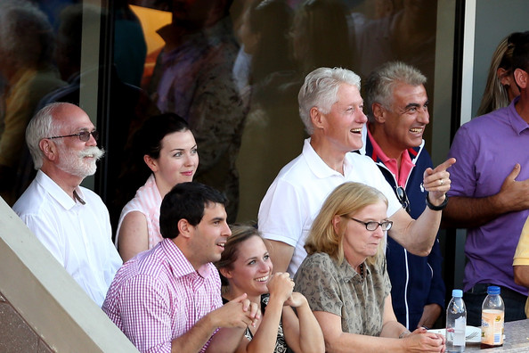 Former President Bill Clinton smiles during the women's singles final match between Victoria Azarenka of Belarus and Serena Williams of the United States of America on Day Fourteen of the 2013 US Open at the USTA Billie Jean King National Tennis Center on September 8, 2013 in the Flushing neighborhood of the Queens borough of New York City.