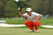 Jin Jeong of Korea lines up a putt on the 2nd hole during day three of the 2014 Australian PGA Championship at Royal Pines Resort on December 13, 2014 in Gold Coast, Australia.