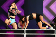 Recording artist Iggy Azalea (L) performs on the Marilyn Stage during day 1 of the 2014 Budweiser Made in America Festival at Los Angeles Grand Park on August 30, 2014 in Los Angeles, California.