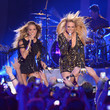 She lets her hair down onstage with Miranda Lambert.