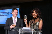 Film Independent President Josh Welsh and actress Angela Bassett toast the nominees at the 2014 Film Independent Filmmaker Grant And Spirit Awards Nominees Brunch at BOA Steakhouse on January 11, 2014 in West Hollywood, California.