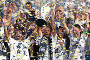 (L-R) Juninho #19, Head Coach Bruce Arena, Landon Donovan #10, Marcelo Sarvas #8 and Robbie Keane #7 of the Los Angeles Galaxy celebrate on the podium with the Philip F. Anschutz Trophy after the Galaxy defeated the New England Revolution 2-1 in the 2014 MLS Cup at StubHub Center on December 7, 2014 in Los Angeles, California.