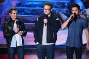 (L-R) Actors Dave Franco, Seth Rogen, and Zac Efron speak onstage at the 2014 MTV Movie Awards at Nokia Theatre L.A. Live on April 13, 2014 in Los Angeles, California.