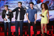 (L-R) Actors Dave Franco, Seth Rogen, Zac Efron and Tiffany Luce speak onstage at the 2014 MTV Movie Awards at Nokia Theatre L.A. Live on April 13, 2014 in Los Angeles, California.
