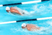 Michael Phelps and Ryan Lochte swim in the Men's 100 Meter Butterfly Prelims during the 2014 Phillips 66 National Championships at the Woollett Aquatic Center on August 8, 2014 in Irvine, California.