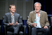"Actor Benjamin McKenzie (L) and producer Bruno Heller speak onstage at the ""Gotham"" panel during the FOX Network portion of the 2014 Summer Television Critics Association at The Beverly Hilton Hotel on July 20, 2014 in Beverly Hills, California."