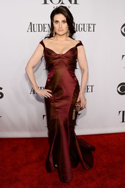 Idina Menzel was a stunner at the Tony Awards in a burgundy Zac Posen off-the-shoulder gown featuring intricate folded accents along the bustline..
