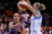 Diana Taurasi #3 of the Phoenix Mercury passes around Courtney Vandersloot #22 of the Chicago Sky during game three of the WNBA Finals at the UIC Pavilion on September 12, 2014 in Chicago, Illinois. NOTE TO USER: User expressly acknowledges and agrees that, by downloading and or using this photograph, User is consenting to the terms and conditions of the Getty Images License Agreement. (Photo by Jonathan Daniel/Getty Images).