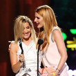 She shares the mic with Bella Thorne.