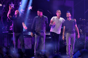 (L-R) Musicians Will Champion, Jonny Buckland, Chris Martin and Guy Berryman of Coldplay perform onstage during the 2014 iHeartRadio Music Festival at the MGM Grand Garden Arena on September 19, 2014 in Las Vegas, Nevada.