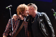 Recording artists Ed Sheeran (L) and Macklemore perform ontage during the 2014 iHeartRadio Music Festival at the MGM Grand Garden Arena on September 20, 2014 in Las Vegas, Nevada.