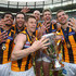 Luke Hodge Jordan Lewis Photos - Cyril Rioli, Jordan Lewis, Sam Mitchell, Jarryd Roughead, Grant Birchall and Luke Hodge of the Hawks celebrate with the trophy after winning the 2015 AFL Grand Final match between the Hawthorn Hawks and the West Coast Eagles at Melbourne Cricket Ground on October 3, 2015 in Melbourne, Australia. - 2015 AFL Grand Final - Hawthorn v West Coast