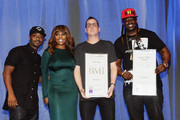 (L-R) Recording artist Ray J and BMI Vice President, Writer/Publisher Relations, Atlanta, Catherine Brewton present record producers Mike Dean and  J-Roc onstage at the 2015 BMI R&B/Hip-Hop Awards at Saban Theatre on August 28, 2015 in Beverly Hills, California.