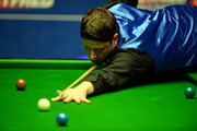 Matthew Stevens of Wales plays a shot against Mark Williams of Wales during day five of the 2015 Betfred World Snooker Championship at Crucible Theatre on April 22, 2015 in Sheffield, England.