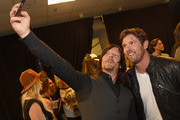Norman Reedus and Noah Galloway attend the 2015 CMT Music awards at the Bridgestone Arena on June 10, 2015 in Nashville, Tennessee.