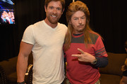 U.S. Army veteran Noah Galloway and David Spade attend the 2015 CMT Music awards at the Bridgestone Arena on June 10, 2015 in Nashville, Tennessee.