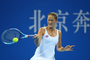 Bojana Jovanovski of Serbia plays a forehand in her match against Caroline Wozniacki of Denmark during day two of the 2015 China Open at the China National Tennis Centre on on October 4, 2015 in Beijing, China.