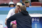 Ana Ivanovic of Serbia talks with her coach after losing the first set against Timea Bacsinszky of Switzerland during their Women's singles semi-finals match on day 8 of the 2015 China Open at the China National Tennis Centre on October 10, 2015 in Beijing, China.