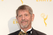 "Peter Coyote, winner of the award for narrator for ""The Roosevelts: An Intimate History,"" poses in the press room during the 2015 Creative Arts Emmy Awards at Microsoft Theater on September 12, 2015 in Los Angeles, California."