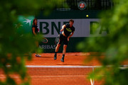 Andy Murray of Great Britain is watched by his coach Amelie Mauresmo as he serves during a practice session on day six of the 2015 French Open at Roland Garros on May 29, 2015 in Paris, France.