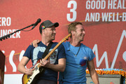 Coldplay guitarist Jonny Buckland and singer, Chris Martin perform on stage at the 2015 Global Citizen Festival to end extreme poverty by 2030 in Central Park on September 26, 2015 in New York City.