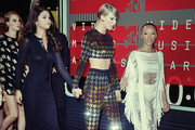 Image proessed using digital filters).Actress Selena Gomez, singer Taylor Swift and actress Serayah arrive at the 2015 MTV Video Music Awards at Microsoft Theater on August 30, 2015 in Los Angeles, California.