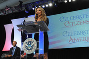 Singer Thalia (R) and former Yankee player Mariano Rivera speak onstage during the Naturalization Ceremony at Festival PEOPLE En Espanol 2015 presented by Verizon at Jacob Javitz Center on October 18, 2015 in New York City.