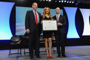 (L-R)  Director of the U.S. Citizenship and Immigration Services Leon Rodriguez, singer Thalia, and Deputy Secretary of Homeland Security Alejandro Mayorkas speak onstage during the Naturalization Ceremony at Festival PEOPLE En Espanol 2015 presented by Verizon at Jacob Javitz Center on October 18, 2015 in New York City.