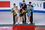 (L-R) Second place winner Cong Han and Wenjing Sui of China, first place winner Meagan Duhamel and Eric Radford, third place winner Qing Pang and Jian Tong pose for the photo after the metal ceremony on March 26, 2015 in Shanghai, China.