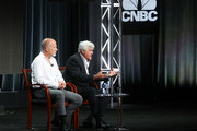 Jim Ackerman, (L) senior vice president, Primetime Alternative, CNBC, and Jay Leno speak during the 2015 Summer Television Critics Association Press Tour at The Beverly Hilton Hotel on August 13, 2015 in Beverly Hills, California.