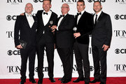 """Director Michael Morris (2nd from R) and author Simon Stephens (2nd from L) and cast and creative of """"The Curious Incident of the Dog in the Night-Time,"""" winner of the award for Best Play, pose in the press room at the 2015 Tony Awards on June 7, 2015 in New York City."""