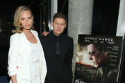 Director Andrew Niccol (R) and Rachel Roberts attend the 2015 Tribeca Film Festival After Party For Good Kill, Sponsored By VDKA 6100 at Jimmy At The James Hotel on April 19, 2015 in New York City.