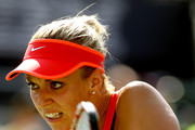 Sabine Lisicki of Germany returns a shot to Simona Halep of Romania during their Women's Singles Fourth Round match on Day Eight of the 2015 US Open at the USTA Billie Jean King National Tennis Center on September 7, 2015 in the Flushing neighborhood of the Queens borough of New York City.