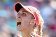 Sabine Lisicki of Germany celebrates a point against  Simona Halep of Romania during their Women's Singles Fourth Round match on Day Eight of the 2015 US Open at the USTA Billie Jean King National Tennis Center on September 7, 2015 in the Flushing neighborhood of the Queens borough of New York City.