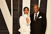 Director John Singleton and guest attend the 2015 Vanity Fair Oscar Party hosted by Graydon Carter at Wallis Annenberg Center for the Performing Arts on February 22, 2015 in Beverly Hills, California.