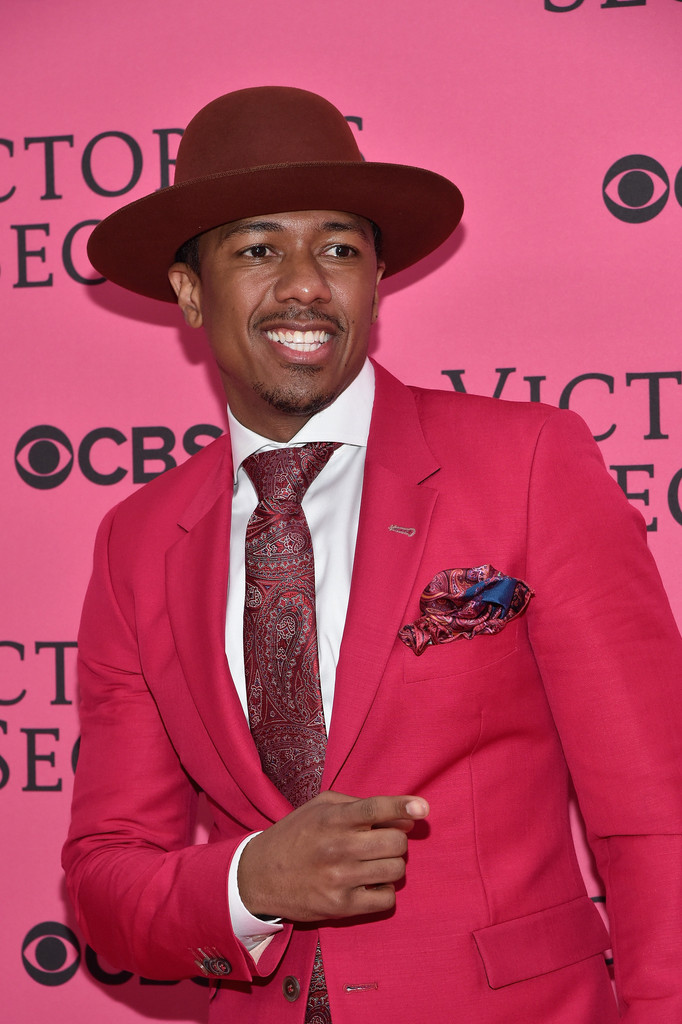 nick cannon sports a bright pink suit for the victorias