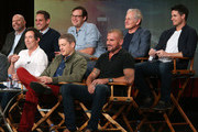 (L-R, Front Row) Actors Tom Cavanagh, Wentworth Miller, Dominic Purcell, (l-r, back row) executive producers Marc Guggenheim, Greg Berlanti and Andrew Kreisberg and actors Victor Garber and Robbie Amell speak onstage during the 'Arrow' and 'The Flash' panel as part of The CW 2015 Winter Television Critics Association press tour at the Langham Huntington Hotel & Spa on January 11, 2015 in Pasadena, California.