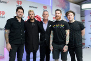 (L-R) Musicians Joe Trohman and Peter Wentz of Fall Out Boy, radio personality Elvis Duran, musicians Andy Hurley and Patrick Stump of Fall Out Boy attend the 2015 iHeartRadio Music Festival at MGM Grand Garden Arena on September 19, 2015 in Las Vegas, Nevada.