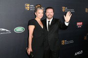 Writer Jane Fallon (L) and honoree Ricky Gervais attend the 2016 AMD British Academy Britannia Awards presented by Jaguar Land Rover and American Airlines at The Beverly Hilton Hotel on October 28, 2016 in Beverly Hills, California.