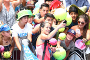 Ana Ivanovic of Serbia takes a photo with fans after her first round match against Tammi Patterson of Australia during day two of the 2016 Australian Open at Melbourne Park on January 19, 2016 in Melbourne, Australia.