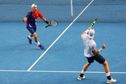 Sam Groth of Australia and Lleyton Hewitt of Australia celebrate winning their second round doubles match against Henri Kontinen of Finland and John Peers of Australia during day six of the 2016 Australian Open at Melbourne Park on January 23, 2016 in Melbourne, Australia.