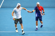 Sam Groth of Australia and Lleyton Hewitt of Australia celebrate a point in their second round doubles match against Henri Kontinen of Finland and John Peers of Australia during day six of the 2016 Australian Open at Melbourne Park on January 23, 2016 in Melbourne, Australia.