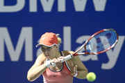 Sabine Lisicki of Germany plays a backhand to Naomi Broady of Great Britain during the Quarter Finals of the 2016 BMW Malaysian Open at Kuala Lumpur Golf & Country Club on March 4, 2016 in Kuala Lumpur, Malaysia.