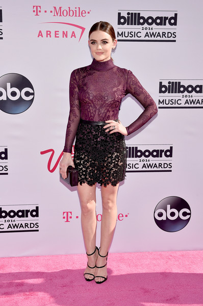 Lucy Hale teamed her top with a see-through black mini skirt, also by Zuhair Murad.