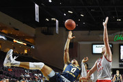 Jordan Davis #0 of the Northern Colorado Bears shoots against Chris Robinson #14 of the Sacred Heart Pioneers during the 2016 Continental Tire Las Vegas Invitational basketball tournament at the Orleans Arena on November 24, 2016 in Las Vegas, Nevada. Northern Colorado won 81-59.